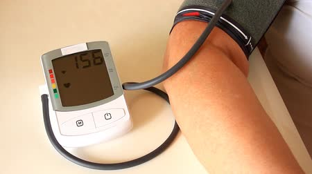 Woman blood pressure with instrument of measurement