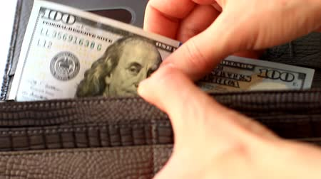 Female hands take out a hundred dollars from wallet Stock Footage