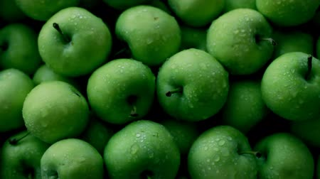 Fresh green apples use as background Стоковые видеозаписи