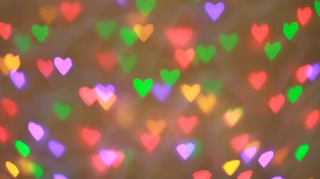 Blinking colorful garlands bokeh in valentine day Wideo