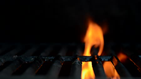 grilling : Flames flare on a grill Stock Footage