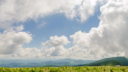 napfény : A time lapse of clouds as they pass over Round Bald in the Roan Highlands on the border of North Carolina and Tennessee.  Stock mozgókép