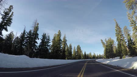 macadam : Road Through Snowy Bryce Canyon on Sunny Day in Early Spring