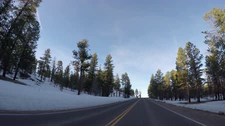 macadam : Snowy Straightaway in Bryce Canyon in early spring Stock Footage