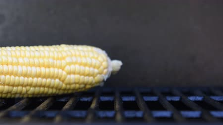 bulaşıklar : Corn Placed on Grill Slide and close up Stok Video