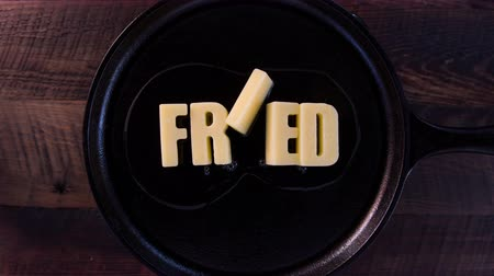 saute : Butter Words Fried on Cast Iron Skillet Background Stock Footage