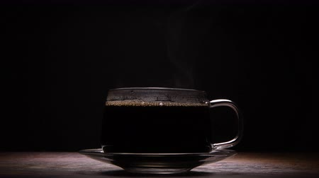 mroczne : Highlighted Coffee Cup on Dark Background