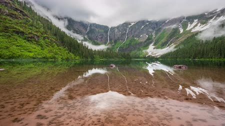 glacier national park : TL Glacier - Avalanche Lake Reflects Mountain and Sky Stock Footage