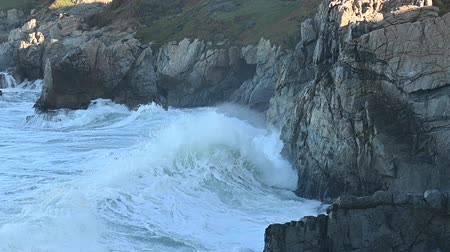 Slow Motion of Waves Crashing into Rocky California Coast on Big Sur Стоковые видеозаписи