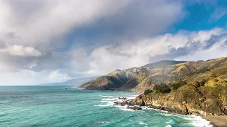 Time Lapse of Big Sur with Big Creek Bridge and Waterfall on sunny winter day
