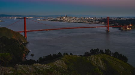 Time Lapse of San Francisco Overlooking the Golden Gate Bridge at Sunset Стоковые видеозаписи