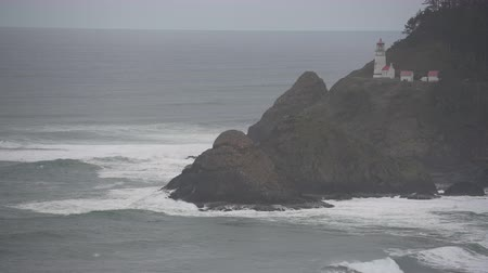 Waves Crash Below Heceta Head Lighthouse along Oregon Coast