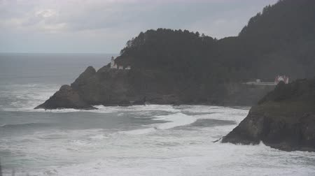 Wide Shot of Heceta Head Light House and Waves along Oregon coast Стоковые видеозаписи