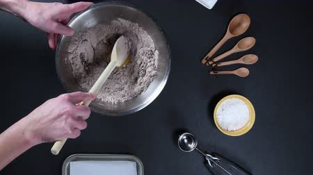 bowls : Mixing Chocolate Cookies with Wooden Spoon from Above