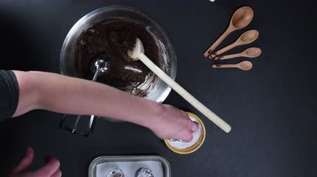 shovívavost : Rolling Chocolate Cookies in Powdered Sugar from Above