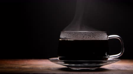 Steam Rises from Hot Coffee in Glass Cup on Right Стоковые видеозаписи