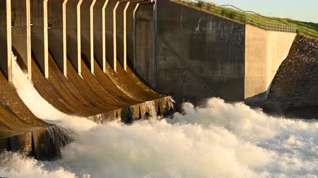 manmade : Close Up of Jackson Dam Spillway flowing with heavy water Stock Footage