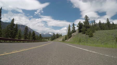 macadam : Curvy Road with the Beartooth Mountains in the Background Stock Footage