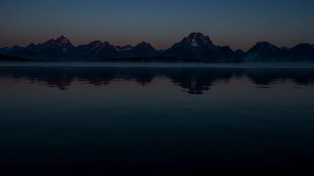 grand tetons : Grand Teton Time Lapse of Sunrise Over Jackson Lake Stock Footage
