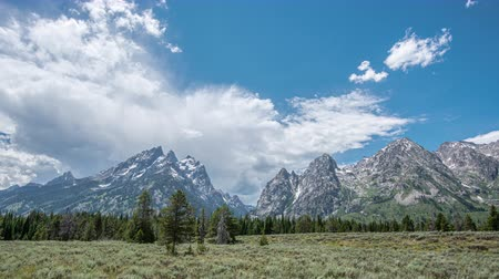 head over : Grand Teton View with clouds streaming over head from a time lapse effect