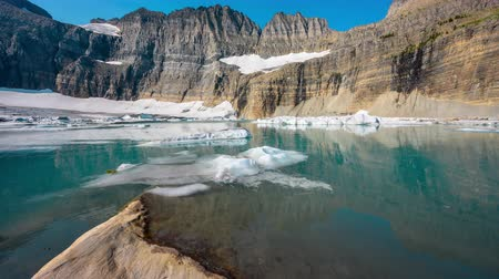 montana : Grinnell Glacier melts in the morning from low vantage point