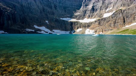 glacier national park : Iceberg Lake Glistens in the Sun of a Summer Day