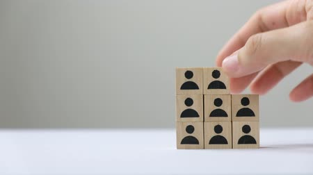 оценка : Hand putting wood cube block to the top, human resource management and recruitment business concept, business Strategy to success.