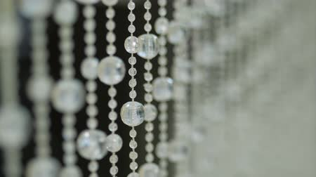 karát : Shining crystal background. Crystal pendants. Crystal stones. Slow motion. Smooth focus