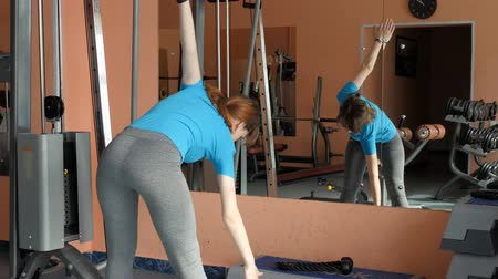 fitballs : Sports Hall. Girl is training in the gym.