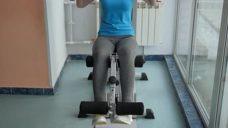 squat : Sports Hall. Girl is training in the gym.