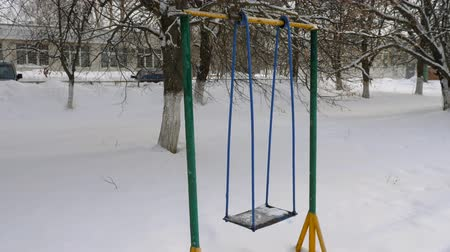snowbound : Metal swing in the snow. Stock Footage