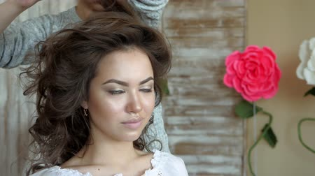 creative makeup : Makeup artist stylist works with model. hairdresser does the hair styling of the model. Stock Footage