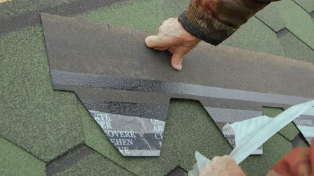 dekarz : Repair of the roof of a residential house. installation of soft tiles. partial replacement of the damaged roof. Dot repair. Removing the protective film from the adhesive base of the roofing material.