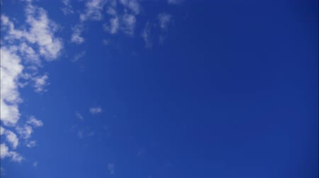 puffy clouds : Timelapse. White clouds float across a blue sky. Stock Footage