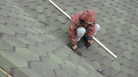 architectural protection : Repair of the roof of a residential building. Dismantling soft tile. Stock Footage