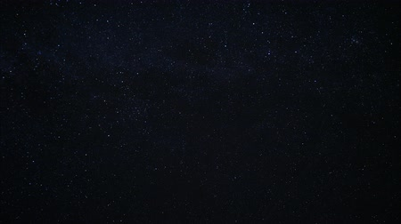 kivonat : Starry night sky. Twinkling stars in the dark night sky. Starfall on a clear starry sky. Fascinating spectacle. Night sky with nebula. Time lapse