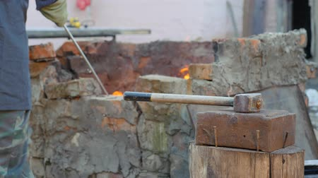 топор : blacksmith works metal. Craftsman, the Highlander on private smithy in the village. sledgehammer lies on the anvil. Master interferes with charcoal in a hot furnace, crucible.
