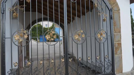 bitki : main entrance of the winery. Forged metal gates decorated with grapevine.