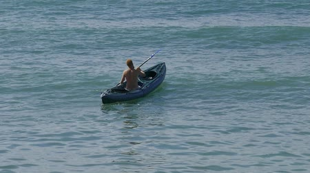 caiaque : man in a kayak storming the sea wave.