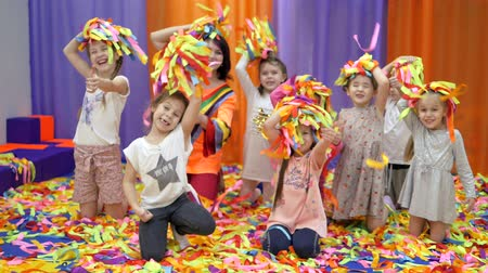 rasgado : Childrens playroom. Studio entertainment for young children. Paper show for children. Tossing paper up.