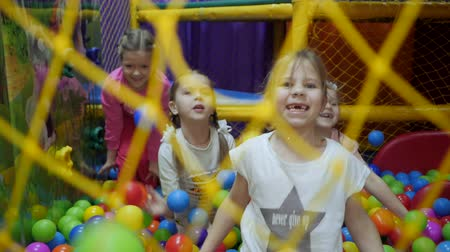 havza : Childrens playroom. Children play in a dry basin filled with plastic colored balls.
