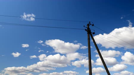 corrente : Electric line pylons against a blue sky.