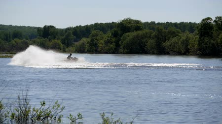 jet ski : Jet ski on the river. Splashes fly apart.