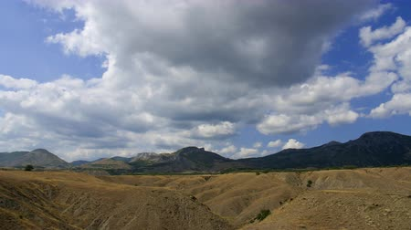 Mountainous landscape. Cirrus clouds are running across the blue sky.