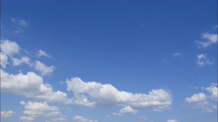 Cumulus clouds against the blue sky. Stock Footage