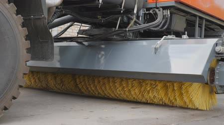 Equipment for cleaning streets and road surfaces. Brush for sweeping asphalt surfaces of streets and airports. Cleaning the street. The stiff-bristled broom twirls. Stock Footage