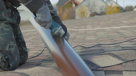 Installation of drainage system of a private house. Metal cutting, hand tools. Stock Footage