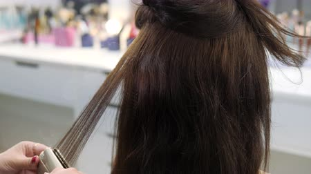 Hair care. Heat treatment treatment of hair strands.
