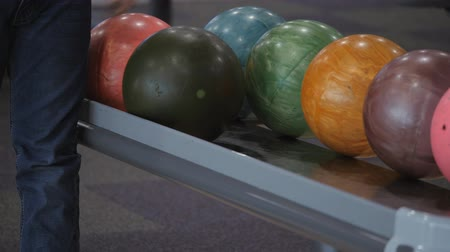 Pastime in bowling. Skating balls on the track with the aim of knocking down pins.
