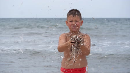Beach summer vacation. Childrens emotions. The child develops tinsel in the wind.